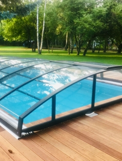Swimming pool roofing